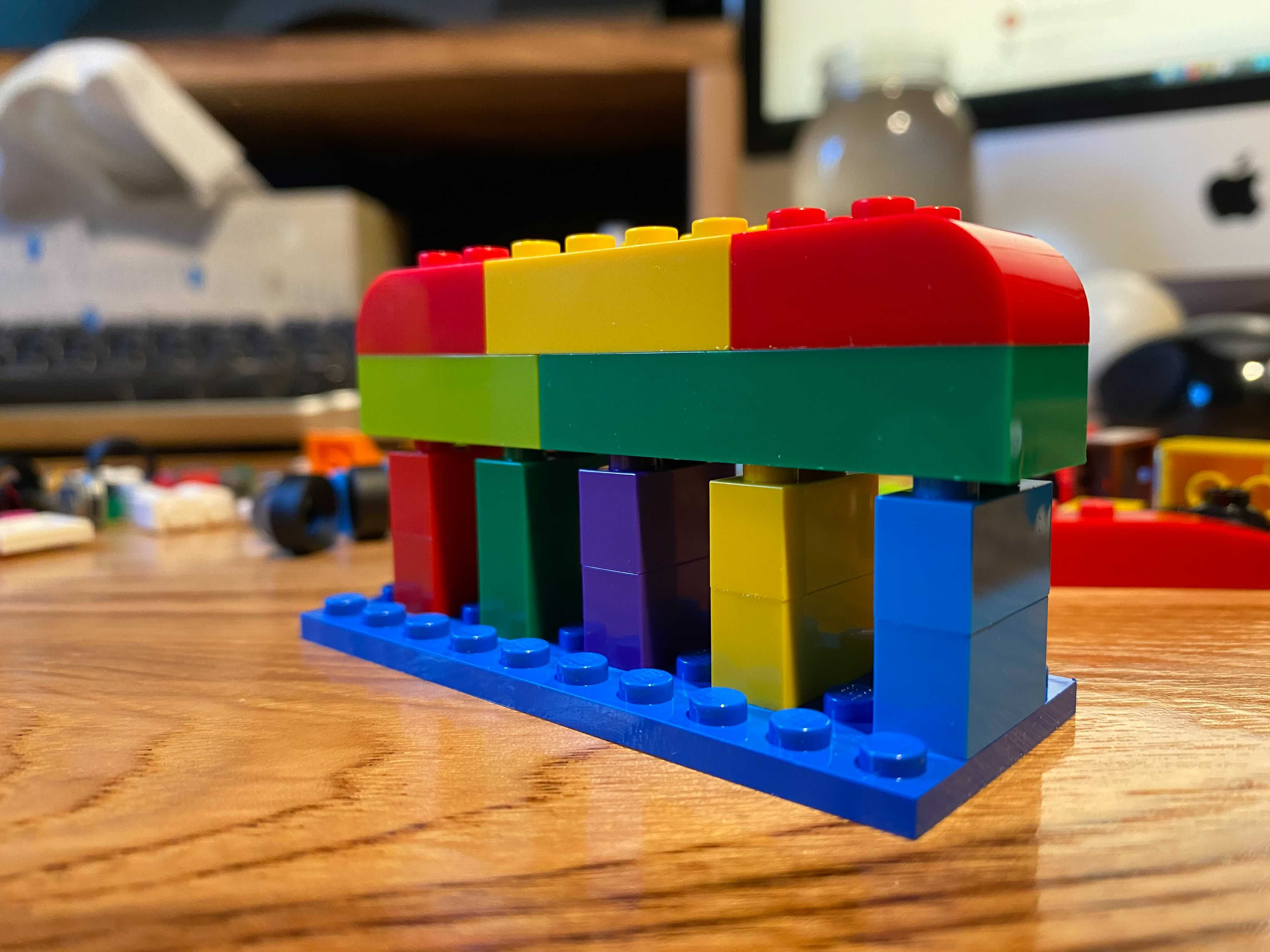"""Some legos representing """"Live as one team with one mission"""" in an abstract way."""